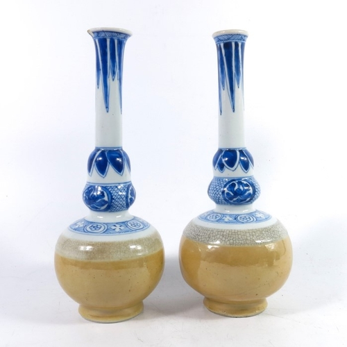 23 - A pair of Japanese porcelain vases, probably 18th century, acorn knopped globe and shaft form, the l...