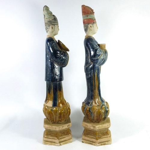 26 - A pair of Chinese Tang style figures, 19th century, polychrome decorated and modelled as court figur...