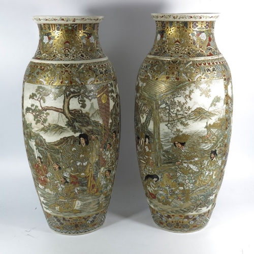 27 - A pair of large Japanese Satsuma vases, Meiji, shouldered form, painted with panels of figures in st...
