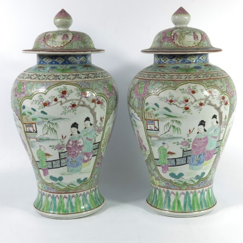 28 - A pair of Japanese famille rose vases, 19th century, in the Chinese Qianlong style, inverse baluster...