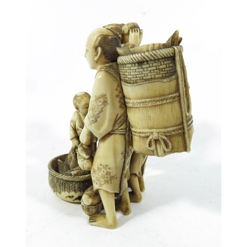 32A - A 19th century Japanese ivory okimono, Meiji, modelled as four farmers with vegetables, 11cm high...
