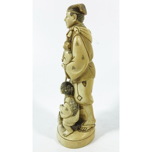 34A - λ A 19th century Japanese ivory okimono, modelled as a man and boy with monkey, 18cm high...