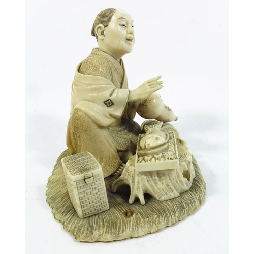 35A - λ A 19th century Japanese ivory okimono, modelled as a man with fish and gourd, 10cm high...