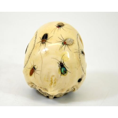 36 - λ A 19th century Japanese Shibayama skull, Meiji, carved and applied with mother of pearl, abalone a...