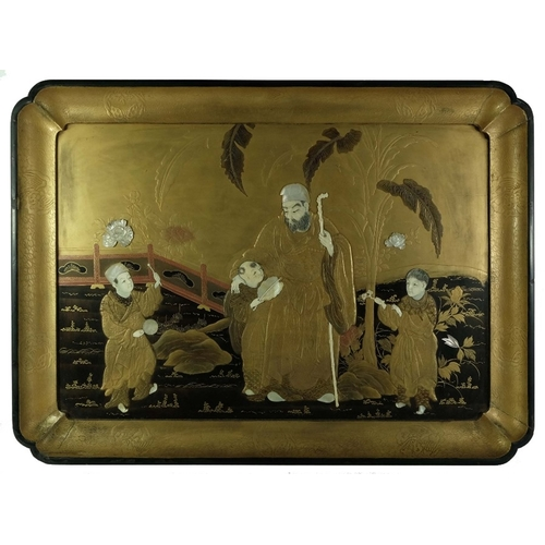 37 - A Japanese Shibayama lacquer tray, decorated with an elder and children in a garden landscape, highl...