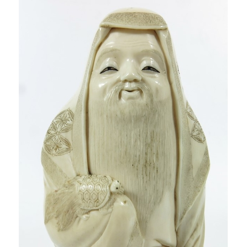 38A - λ A 19th century Japanese ivory okimono, of a man with turtle, 20cm high...