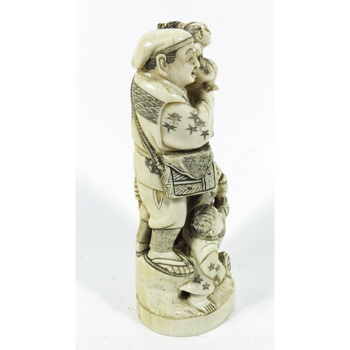39A - λ A 19th century Japanese ivory okimono, modelled as men and boys, 19cm high...