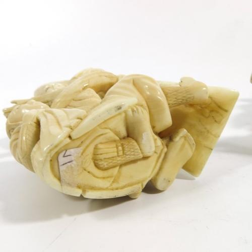 46 - λ A pair of 19th century Japanese ivory figures, Meiji, each with three Samurai, 16.5cm high (2)...
