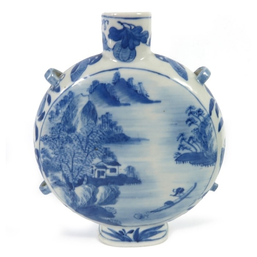 8 - A Chinese blue and white moonflask, Kangxi mark, four handles, painted with watery landscape to one ...