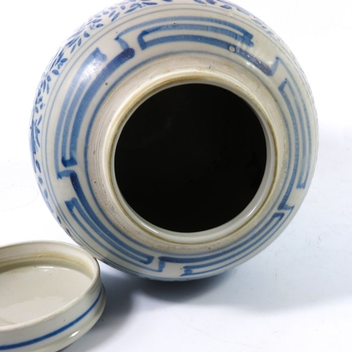 9 - A Chinese blue and white ginger jar, stencilled foliate scroll and geometric block design, 24.5cm hi...