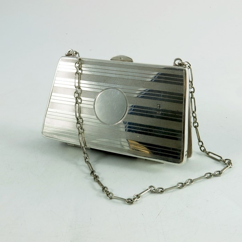 117 - A George V silver evening purse , Birmingham 1917, solid sided with leather concertina pouch interio...