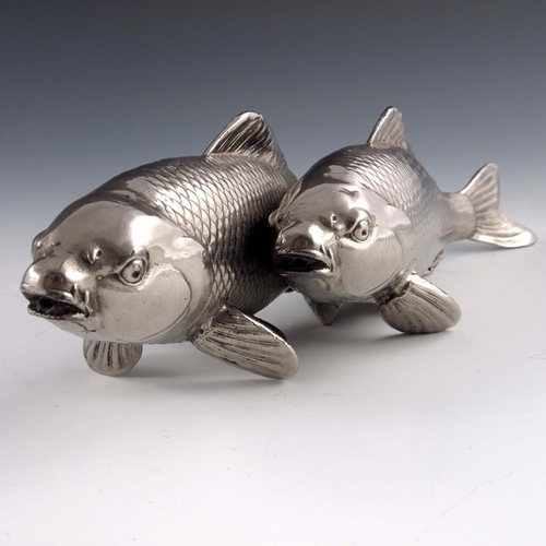 1 - A Japanese white metal or plated figure group of two carp, realistically modelled, cast character ma...