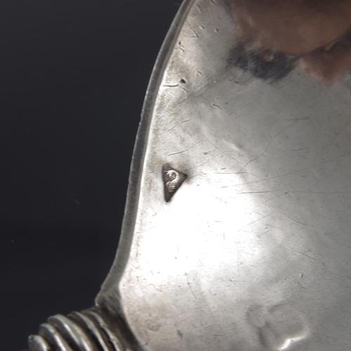 22 - A 17th century Dutch silver spoon, Gerrit Hendricks, Bolsward circa 1620, the handle cast as a polla...
