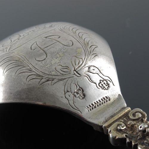 23 - A 17th century Dutch silver spoon, circa 1625, the hexagonal section tapered stem with cast mask ter...