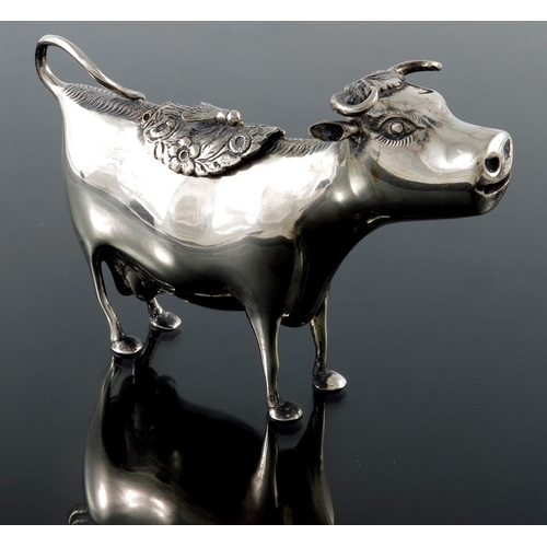 24 - A Dutch silver cow creamer, in the form of a standing cow, early 20th century, pseudo mark, 14.5cm l...