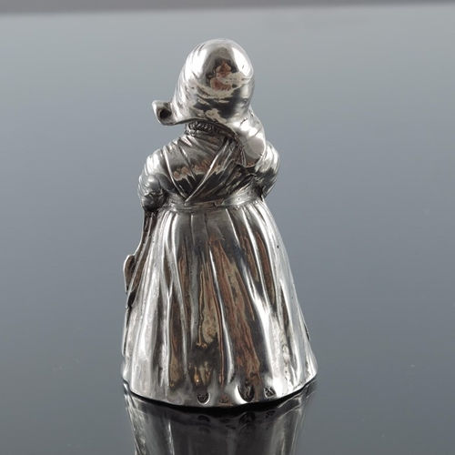 28 - A Continental silver figural bell, modelled as a Dutch girl, pseudo marks, 8.5cm high, 3.02ozt...