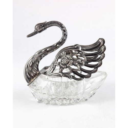 31 - A Continental silver and glass swan bowl, E Ltd., London import marks 1981, cut glass body and pierc...