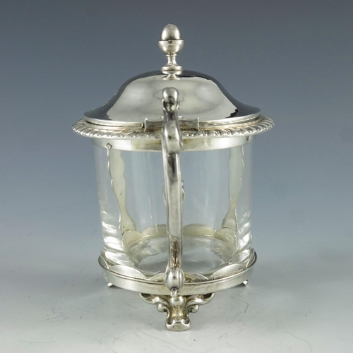 33 - Emile Hugo, Paris circa 1860, a French silver mustard pot, cylindrical form with two cast baluster p...