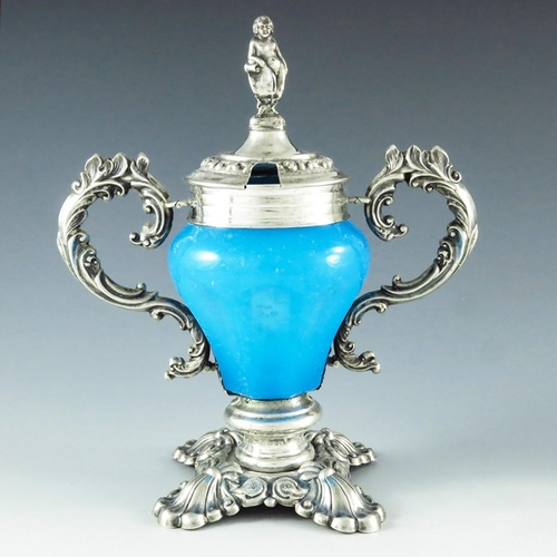 34 - A P, Vienna 1854, a 19th century Austrian silver and glass mustard pot, the pear shaped slice cut bl...
