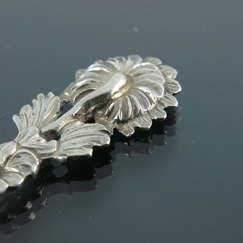 35 - An 18th century cast silver teaspoon, probably French, circa 1750, realistically modelled as a flowe...