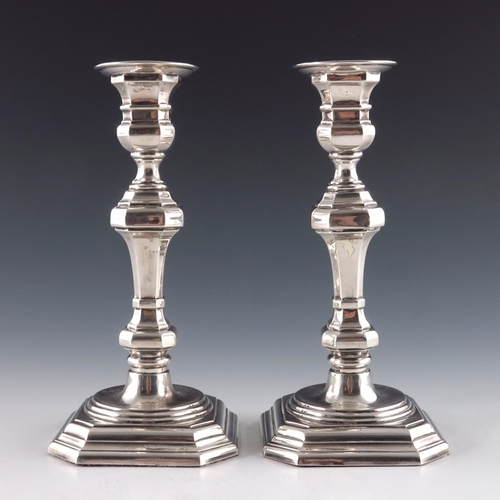36 - A pair of Spanish silver candlesticks, in the 18th century style, octagonal section knopped baluster...