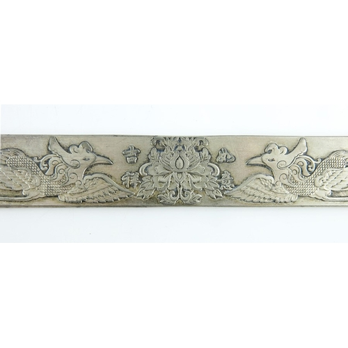 4 - A Chinese silver ingot, rectangular form, cast with phoenix birds flanking a lotus flower, stamped m...