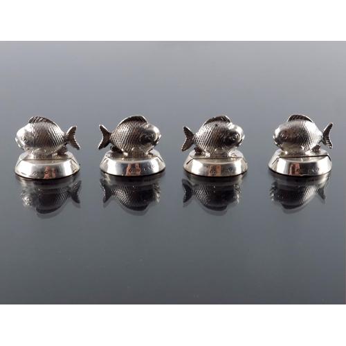 52 - A set of four George V novelty silver menu holders, Sampson Mordan, Chester 1913, modelled as fish, ...