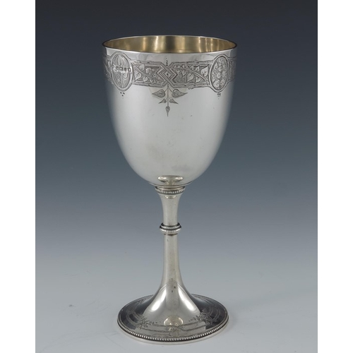 55 - A Victorian silver goblet, Fenton Brothers, Sheffield 1877, engraved with a band of leafy branches p...