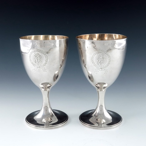 60 - A pair of George III silver goblets, James Darquites, London 1795, plain egg cup form on splayed fee...