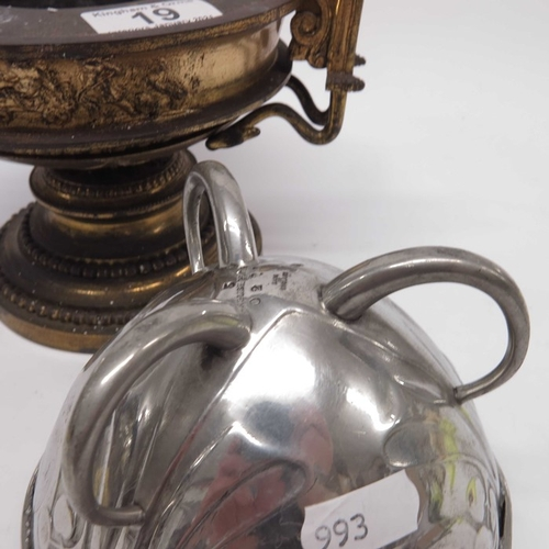 19 - A late Victorian cast metal epergne base, with figural frieze on stepped circular base, a silver pla...