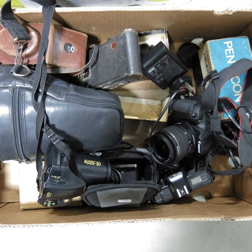 21 - Cameras and camera equipment to include a Canon EOS 1300D, a Sony Cybershot, a Minolta 5000, an Olym...