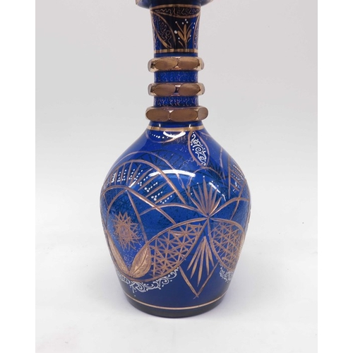 26 - A large Bohemian blue glass decanter and stopper,  baluster form, triple ringed neck with Persian st...