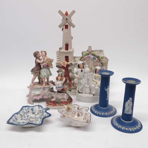 29 - A late Victorian Staffordshire flat back model of a windmill,  two other examples, couple by a sprin...