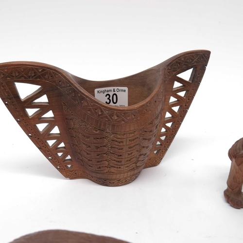 30 - A Scandinavian carved wooden winged wedding cup, a carved wooden figure of a Saint Bernard, a key ri...