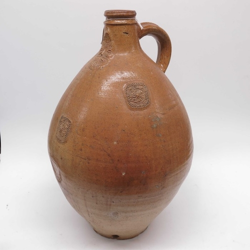 35 - A large Bellarmine stoneware jug, with ferruginous glaze, with ring handle, the neck moulded with th...