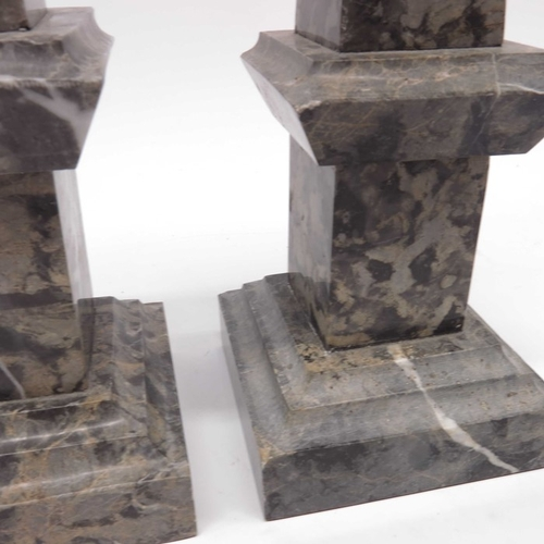 38 - A pair of marble obelisks. square sectional form  on stepped bases, 40cm high  (2)...