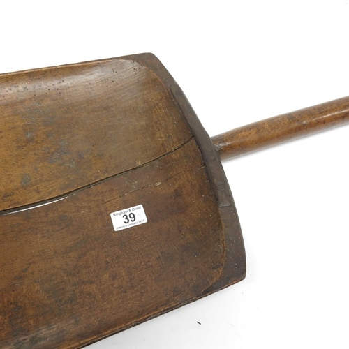 39 - A 19th Century wooden grain shovel with iron work edge and D shaped handle, 102cm length, and a turn...