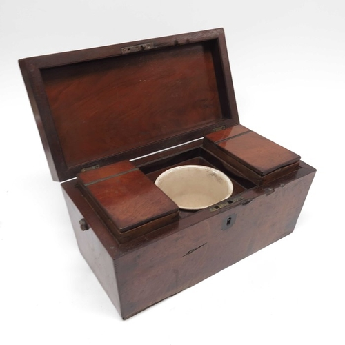 52 - An early Victorian red walnut veneered sarcophogal shaped tea caddy...