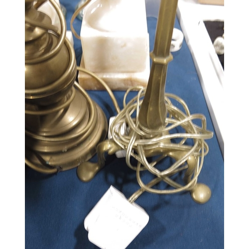 54 - A pair of white onyx pedestal table lamps, reeded baluster form, a brass table lamp and a desk lamp ...