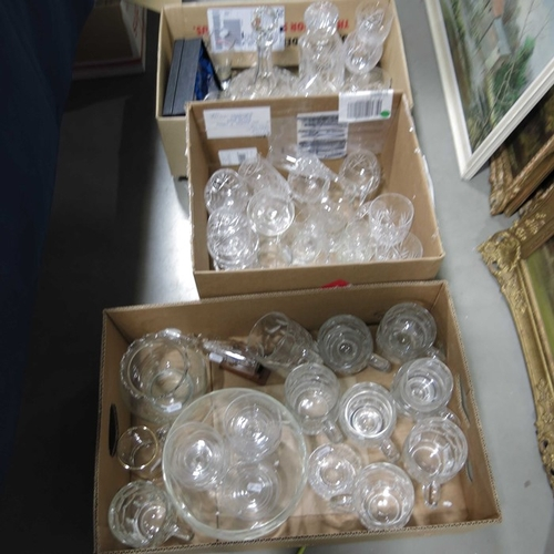 55 - Sundry glassware to include drinking glasses, ship's decanter, and dessert sets.  (3 boxes)...