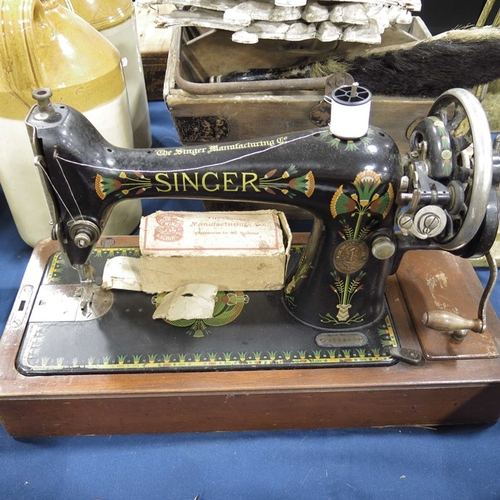 59 - A Singer hand sewing machine, model number F8828609, in case....