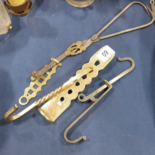 60 - A 19th century brass and iron patented open fire meat hanger, two brass ratcheted hooks, a pair of b...
