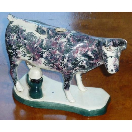 1 - A mid 19th Century Staffordshire Potteries spongeware style pottery Cow Creamer (minus cover and dam...