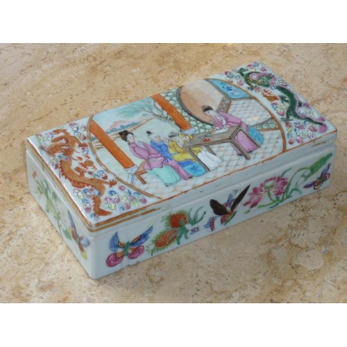 101 - A 19th Century Chinese porcelain lidded Pen Box decorated in the Famille Rose palette with figures, ...