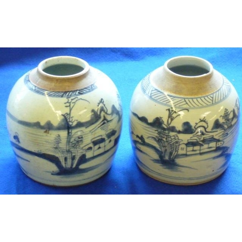 105 - A pair of 19th Century provincial Chinese porcelain Jars (minus covers), each decorated with buildin...