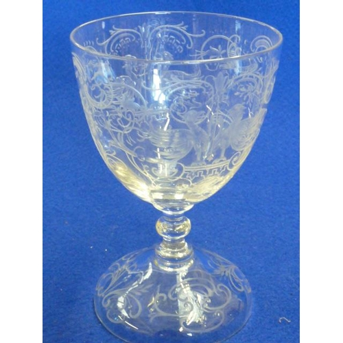 117 - A single clear glass Goblet very finely engraved with eagles, scrolling foliage and flowers on pedes...