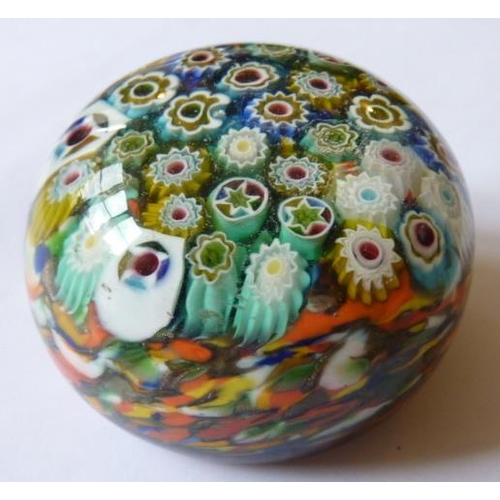 118 - A circular glass Paperweight with Millefiore style canes, 6.25cm diameter...