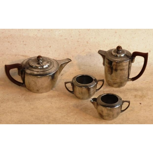 124 - A Liberty's Tudric pewter four-piece Tea Service with hammered finish, marked to base Liberty & Co.,...