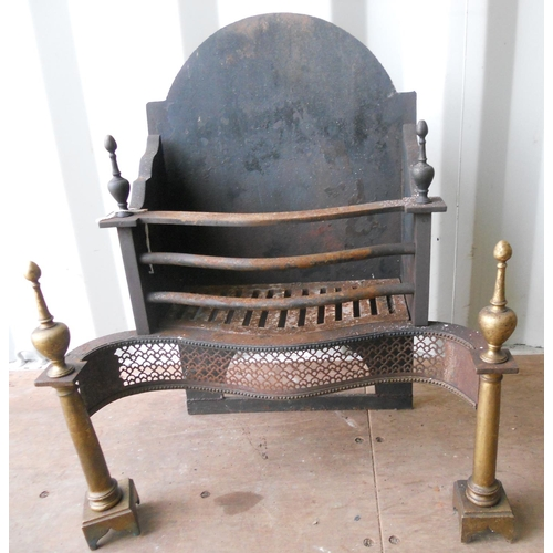 126 - A large and heavy cast iron and brass Fire Grate in late 18th Century style, the pierced serpentine ...