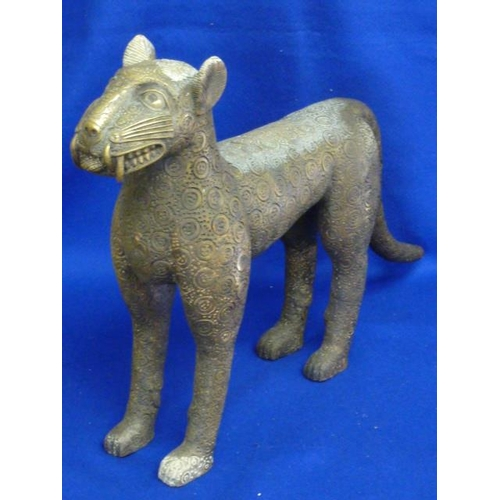 131 - A large and very heavy Eastern brass/bronze stylised Model of a Leopard standing four-square, hollow...